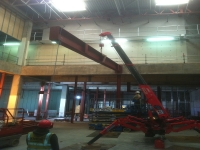 Mini Spider Crane Hire - erecting steel in a building with an electric powered crane.