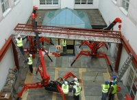 Mini Cranes carrying out tandem lifts in a courtyard in Limerick.